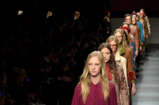 Models on the catwalk at a Gucci show