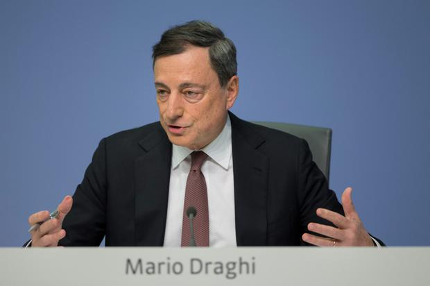 ECB President Mario Draghi announces the interest rate decision at the bank's headquarters in Frankfurt yesterday. Photo: Bloomberg