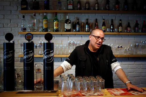 Sales are down among bar regulars, says Beer Shooter franchise manager Ricardo Gil at the imported and locally-brewed craft beer shop in Madrid this week. Photo: Reuters