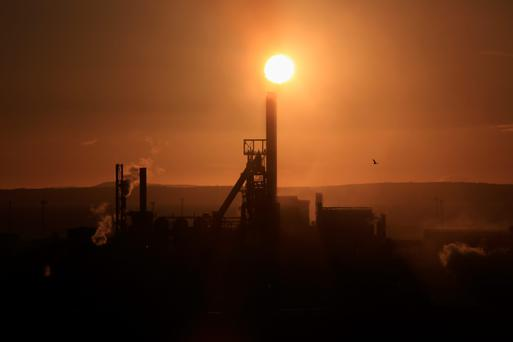 The sun sets behind the Tata Steel plant at Port Talbot. Photo: Getty Images