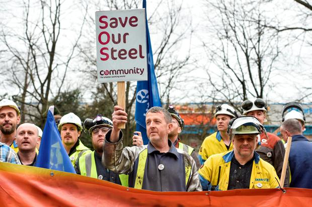 Workers with banners at the Port Talbot plant in Wales. Photo: Bloomberg