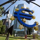 ECB keeps rates unchanged, revises inflation outlook