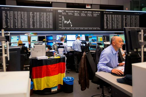 Financial traders monitor data inside the Deutsche Boerse ahead of the merger with the LSE. Photo: Bloomberg