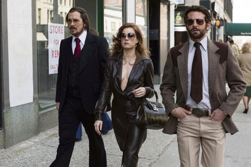 Christian Bale, Amy Adams and Bradley Cooper in 'American Hustle'