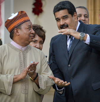 Mohammed Barkindo, secretary general of Opec, with Venezuelan president Nicolas Maduro at the presidential palace in Caracas earlier this month Photo: Carlos Becerra/Bloomberg