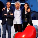 Beppe Grillo (centre), the founder of the anti-establishment 5-Star Movement, stands with Rome's Mayor Virginia Raggi and Luigi Di Maio during a march in support of the 'No' vote
