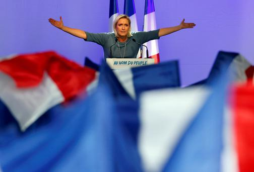 Marine Le Pen, French National Front (FN) political party leader, gestures during an FN political rally in Frejus, France