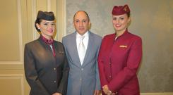 Qatar Airways CEO Akbar Al Baker with cabin crew Bernadet Nagy and Maja Olovcic in Dublin