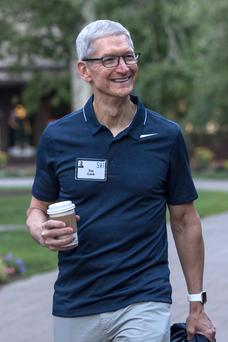 Tim Cook, chief executive officer of Apple Inc., walks the grounds after a morning session during the Allen & Co. Media and Technology conference in Sun Valley, Idaho
