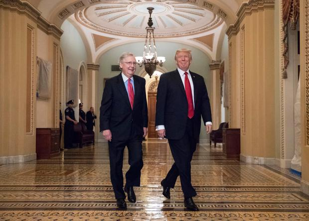 US President Donald Trump, escorted by Senate Majority Leader Mitch McConnell, on Capitol Hill to push for his tax-reform agenda Photo: AP