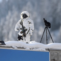 A police sniper secures a roof next to the Congress Centre on the eve of the opening day of the World Economic Forum in Davos last year. Photo: AFP/Getty Images