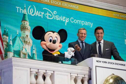 Mickey Mouse and Bob Iger, chairman and CEO of The Walt Disney Co, ring the opening bell on Wall Street last year with Tom Farley, president of the New York Stock Exchange Group