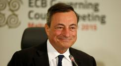 ECB President Mario Draghi says protectionism is a risk