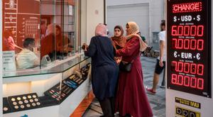 Women exchange currency at an office in Istanbul