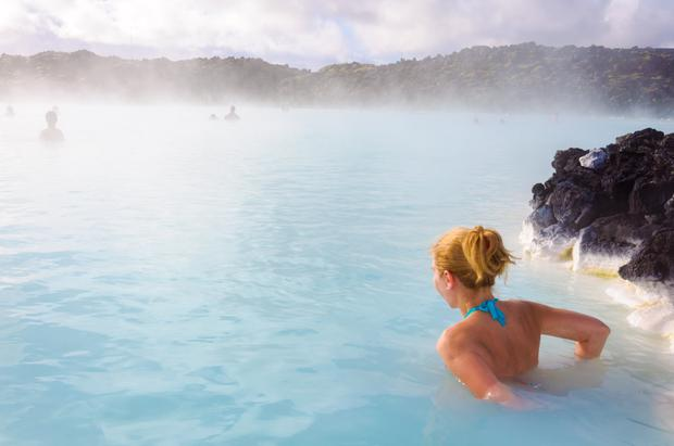 Slowdown: A tourist in the popular Blue Lagoon. While the number of visitors rose nearly 40pc in 2016, the increase was only 24pc in 2017