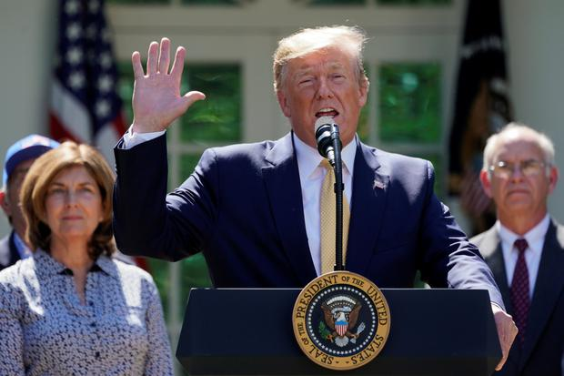Wave of support: American President Donald Trump is benefiting from a strong economy and a high happiness index. Photo: REUTERS/Kevin Lamarque