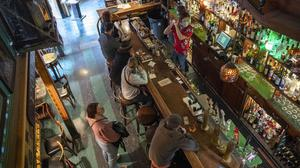 A bartender makes a drink in a quiet bar in San Francisco which this week became the first major US city to require proof of full vaccination against Covid-19 for a variety of indoor activities that involve eating, drinking or exercising. Photo: David Paul Morris/Bloomberg