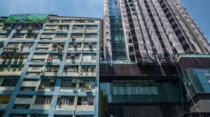The Vertex residential project developed by China Evergrande, right, in the Cheung Sha Wan area of Hong Kong, China, on Friday, July 23, 2021. HSBC Holdings Plc and Bank of China Ltd.'s Hong Kong unit are reconsidering their decisions to halt mortgages for China Evergrande Group's unfinished residential properties in Hong Kong, after the city's de facto central bank questioned the moves, according to people familiar with the matter. Photographer: Lam Yik/Bloomberg