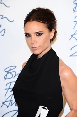 Victoria Beckham with the Designer Brand award at the 2011 British Fashion Awards (Ian West/PA)