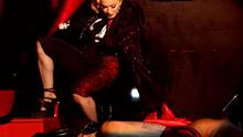 Catch a falling star: Her Madjesty takes a tumble on stage at the Brits