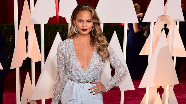 Chrissy Teigen has said she was wrong to hold the bug in front of her daughter (Ian West/PA)