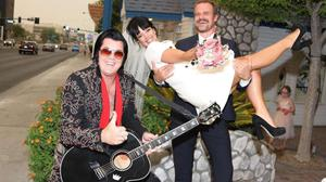 An Elvis impersonator poses with Lily Allen and David Harbour after marrying them in Las Vegas on Monday