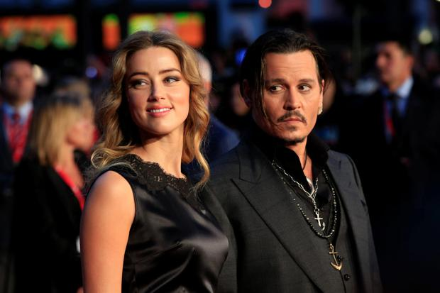 Johnny Depp and estranged wife Amber Heard; the pair have settled their divorce. Photo: Jonathan Brady/PA Wire