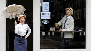 In character: Darina Gallagher plays Molly watched by Tom Fitzgerald during a Bloomsday event on Lincoln Place in Dublin. Photo: Gerry Mooney