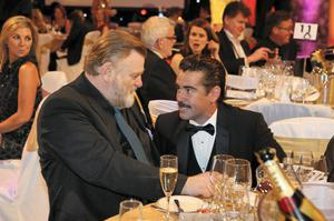 Colin Farrell speaking with Brendan Gleesson at the  IFTA Awards 2014 at the Double Tree by Hilton Hotel, Dublin