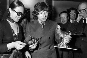Polanski and friend with the Prix Raoul Lévy award from the French film industry for directing the classic thriller
