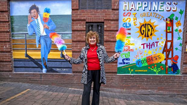 Lady Anne Dodd unveils the mural of Ken Dodd at the Liverpool Royal Court Theatre (Peter Byrne/PA)