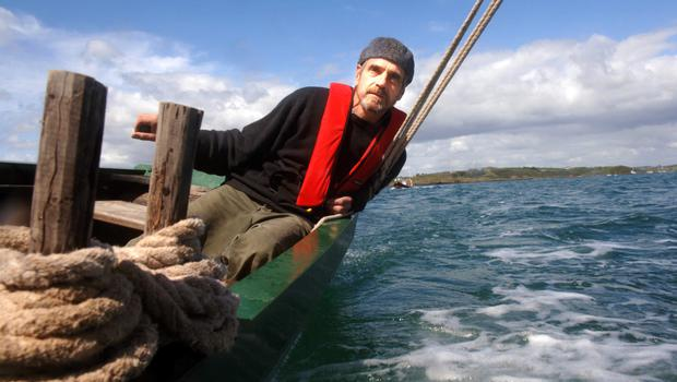 Jeremy Irons sailing a lobster boat in Baltimore harbour, Co Cork