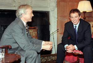 Britain's then-prime minister Tony Blair talks with a younger John Humphrys (Adam Butler/PA)