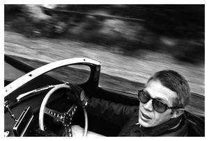 Driving ambition: Steve McQueen behind the wheel of his XK-SS Jaguar in Los Angeles in 1962.