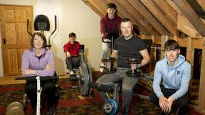 Mum Joanne and Dad Tommy with sons (from left) Alan, Kevin and Conor in their home gym.