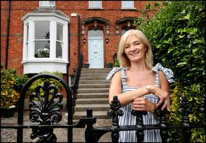 Noelle outside her period house, which is situated in a leafy square in Dublin 6. It dates from 1850, and has lovely details including bay windows, high ceilings and period mantlepieces