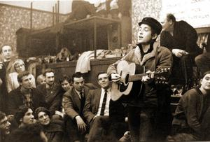 Bob Dylan performing at the Singers Club Christmas party in London in December 1962 on his first visit to Britain. Photo: Brian Shuel/Redferns