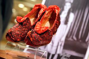 One of the pairs of ruby slippers from The Wizard Of Oz which have made big bucks.