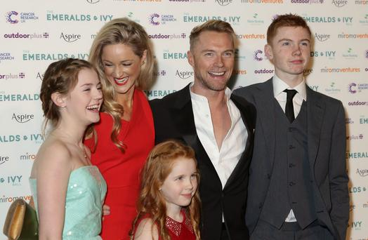 Smiles: Ronan Keating and girlfriend Storm Uechtritz, with his three children (left to right) Missy, Ali and Jack attending the Emeralds and Ivy Ball