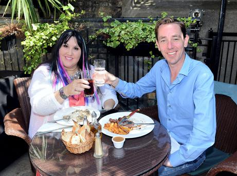 Bon Appetit: Ryan Tubridy and Andrea Smith dine al fresco in the sunshine at French restaurant, Chez Max, Dublin. Photo: Dave Meehan.