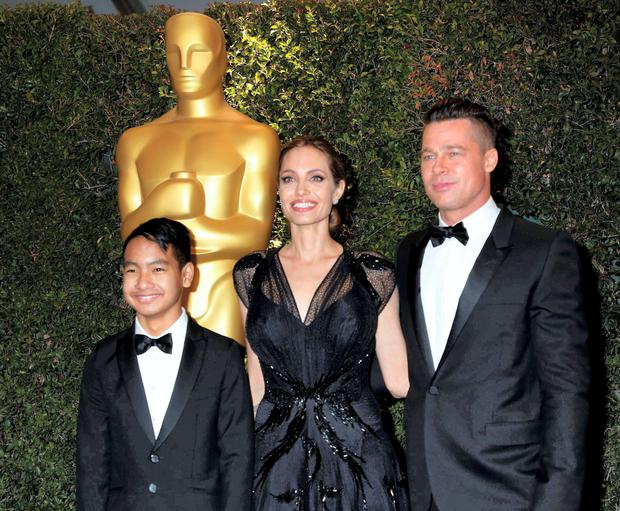 Angelina Jolie and Brad Pitt with their son Maddox at the Oscars. Photo: Fred Prouser