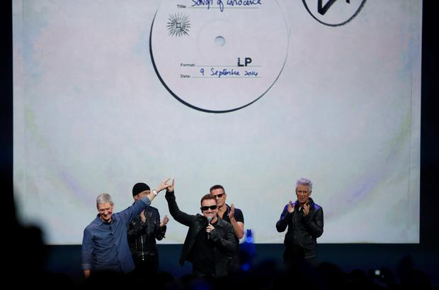 Tim Cook of Apple with U2