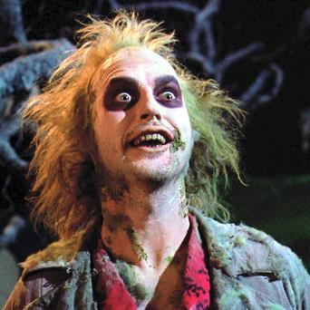 Tailor-made: Keaton played the deranged 'bio-exorcist' spook in 1988's Beetlejuice; his terrifying performance would land him the title role in Batman