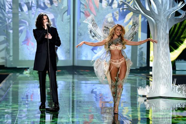 Singer Hozier performs onstage as model Candice Swanepoel walks the runway during the 2014 Victoria's Secret Fashion Show at Earl's Court Exhibition Centre in London last week. Photo: Getty