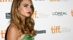 Eyebrows, insouciance, and attitude: Fashion model and actress Cara Delevingne