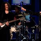 Hozier and Annie Lennox perform on stage at the 57th Annual Grammy Awards in Los Angeles