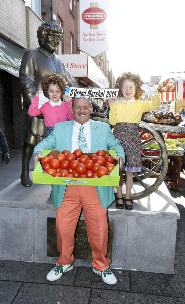 Brendan O'Carroll on Moore Street in Dublin with Ella Hannon, (6) from Mountmellick, Co Laois and Eva Crean, (7) from Stepaside, Dublin. Photo: Robbie Reynolds