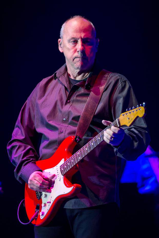 Mark Knopfler on stage in Ljubljana. He says he has survived fame because he was in his late twenties when he achieved it.