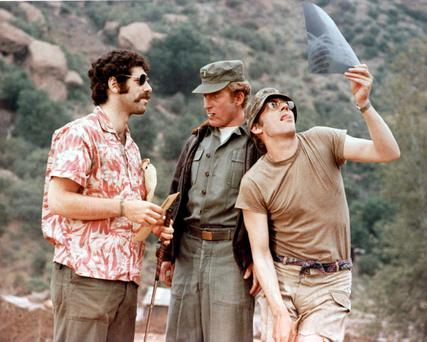 Elliott Gould (left) and Donald Sutherland (right) in the film version of MASH.