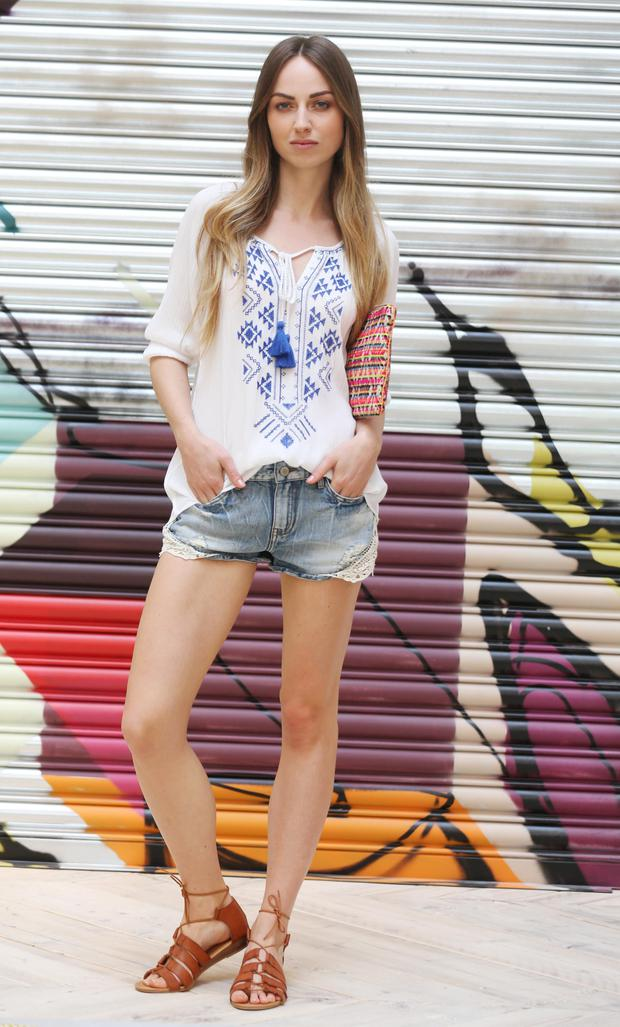 Daniella wears Penneys top (€13), shorts (€15), bag (€10) and shoes (€18). Photo: Leon Farrell / Photocall Ireland